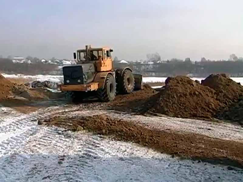 Снятие торфяного слоя до грунта тракторами и бульдозерами